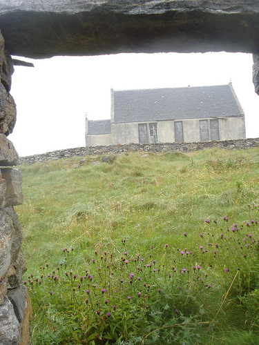 View from ruined home of Margaret Teresa McBain looking at old Torlum  school house, Benbecula